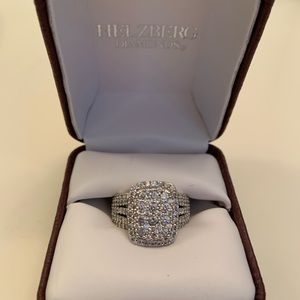 This is a size 6, 2 caret cluster diamond ring.